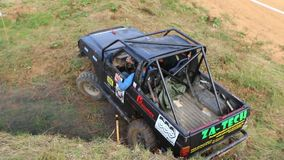 Black off road car in difficult terrain stock video