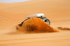 Black off-road car fetching a dune, Libya - Africa. Another view Royalty Free Stock Photos