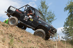Black off road car is sliding down a steep slope Royalty Free Stock Image