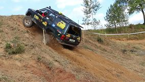 Black off road car is on the steep hill stock video