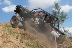Black off road car is on the top of the steep hill Royalty Free Stock Photo