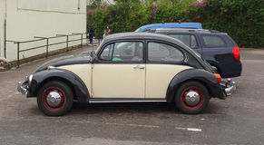 Black and off white Volkswagen Beetle car in Prague Stock Photo