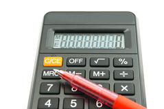 Black office calculator and pen Royalty Free Stock Photo