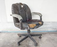Black Office chair old damage leather and dirty Stock Image