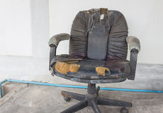 Black Office chair old damage leather and dirty, time to replace Stock Image
