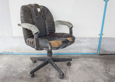 Black Office chair old damage leather and dirty, time to replace Stock Photos
