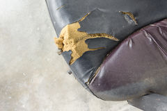 Black Office chair old damage leather and dirty, time to replace Royalty Free Stock Photos
