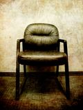 Black Office Chair with Textured Wall Stock Photos