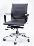 Black Office Chair. A black office chair with white background Royalty Free Stock Images