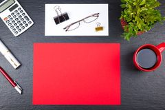 Black Office desk table with computer, pen and a cup of coffee, lot of things. Top view with copy space. Royalty Free Stock Image
