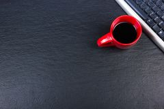 Black Office desk table with computer, pen and a cup of coffee, lot of things. Top view with copy space. Stock Photo