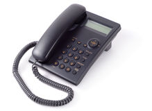 Black Office Phone. Single black telephone isolated over white background Stock Image