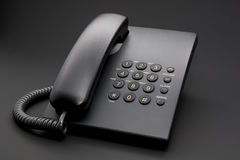 Black office phone on black Royalty Free Stock Photo