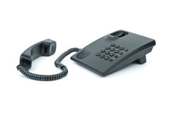 Black office phone with handset near. Isolated on the white background Stock Photos