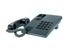 Black office phone with handset near isolated. On the white background Royalty Free Stock Image