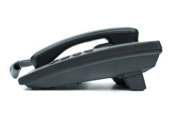 Black office phone. Side view. Isolated on white background Stock Photo