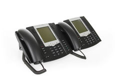 Black office phones isolated on white Stock Image