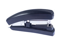Black office stapler on black background Stock Image