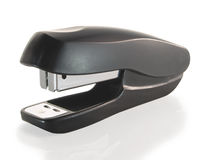 Black office stapler, close-up. On a white background royalty free stock photography