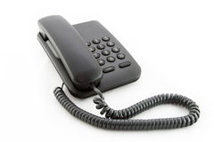 Black office telephone. On a white background Stock Image