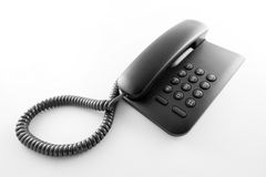 Black office telephone. On a white background Stock Photo