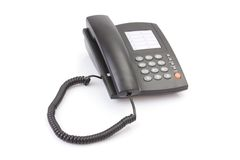 Black office telephone isolated on white Royalty Free Stock Photos