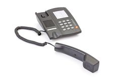Black office telephone off hook Stock Photo