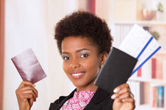 Black office woman tickets and passport. Black office woman holding up tickets and passport document smiling concept transport airplane airline bus train Stock Photography