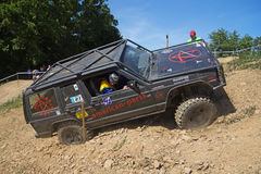 Black offroad car in the rough terrain Royalty Free Stock Photo