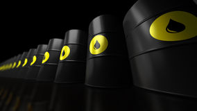 Black Oil Barrels. Oil Barrels on black background with reflection and Depth of field Royalty Free Stock Image