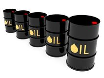 Black oil barrels located by diagonal Stock Images
