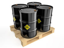 Black  oil   barrels on pallet. On   white background Royalty Free Stock Photos