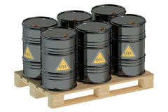 Black oil barrels on pallet. On white background Stock Photos