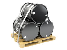 Black oil barrels on wooden pallet Stock Image