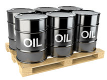 Black oil barrels on wooden pallet Royalty Free Stock Images