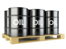 Black oil barrels on wooden pallet Royalty Free Stock Image