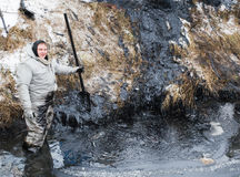 Black oil cleanup Stock Image