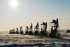 Black oil pump. On winter North Royalty Free Stock Image
