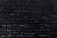 Black old brick wall detailed texture for background stock image