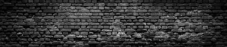 Black Old Brick wall panoramic background in high resolution. Black Brick wall panoramic background. Old Red stone blocks texture, high resolution panorama Royalty Free Stock Image