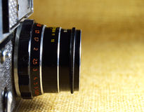 Black old camera lens close-up. On canvas Stock Photography
