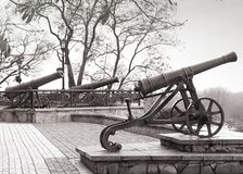Black old cannons on hill. Military gun. stock images