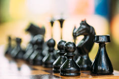 Black Old Chess Figures Standing On Chessboard Royalty Free Stock Photos