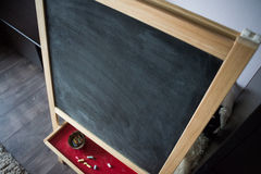 Black old empty chalkboard for copy space with colorful pieces of chalk. Royalty Free Stock Photo