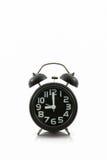 Black old fashion alarm clock. Black old fashion alarm clock on white background Stock Image