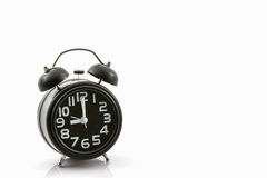 Black old fashion alarm clock. Royalty Free Stock Images