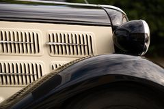 Black Old-fashioned Car. The front side of a black, old-fashioned car [9795_B Royalty Free Stock Image