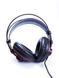 Black old headphone on white background Stock Photos