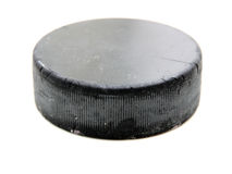 Black old hockey puck Royalty Free Stock Photos