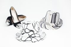 Old ladies shoe on high heels and and a hat. Black old ladies shoe on high heels with a hat on a white background stock image